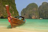 stock photo of phi phi  - Colorfully decorated boat at Maya Bay - JPG