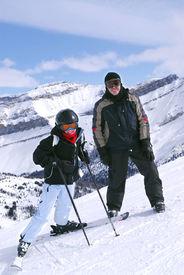 stock photo of family vacations  - Family downhill skiing vacation  - JPG