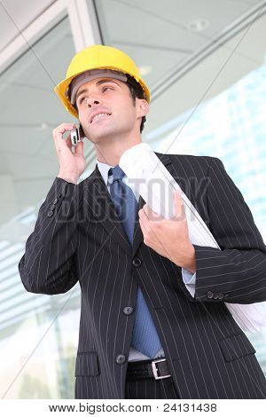 Handsome young Man architect on a building construction site