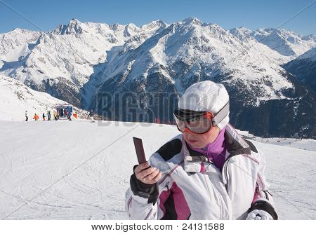 Skier In The Mountains With A Mobile Phone
