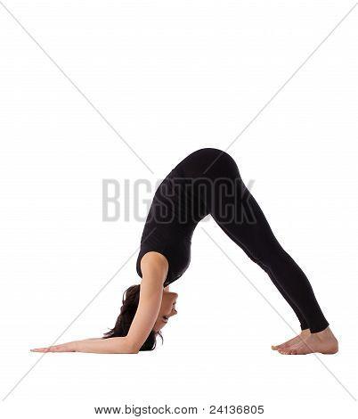 woman stand in yoga pose - Adho Mukha Svanasana