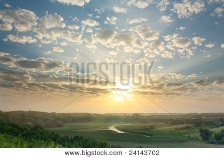 Magic Summer Sunset Over Rural Expanses
