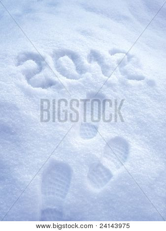 Foot step print in snow - New Year 2012 concept