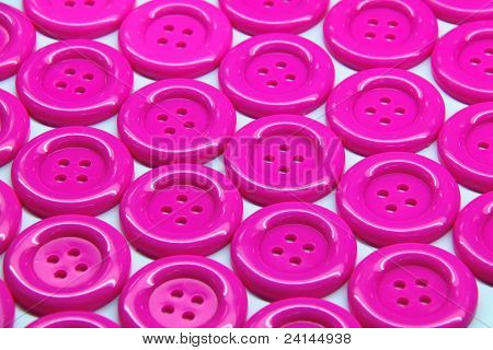 Pattern Of Pink Buttons On White Background