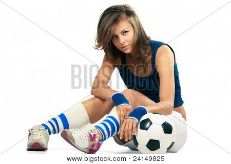 Sexy girl doing fitness, abdominal exercises with soccer ball over white background