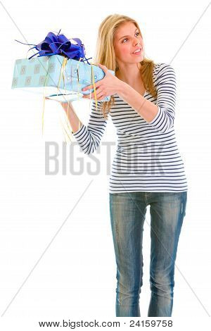 Interested Teen Girl Shaking Present Box Trying To Guess What's Inside
