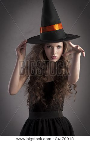 Pretty Girl Wearing A Huge Witch Hat