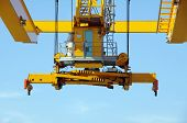 pic of boom-truck  - Spreader of a industrial crane on blue sky - JPG
