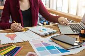 Young Woman Designer Working As Fashion Designers At Work With Fashion Sketches And Color Charts, Pr poster