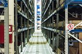 Defocused Image Of Tiered Storage Facility At Machinery Industrial Plant. Factory Warehouse With Spa poster