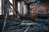 Ruins Of Burned Brick House After Fire Disaster Accident. Heaps Of Ash And Arson, Burnt Furniture, C poster