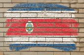 Flag Of Costarica On Grunge Brick Wall Painted With Chalk
