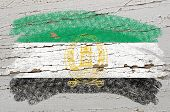 Flag Of Afghanistan On Grunge Wooden Texture Painted With Chalk