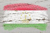 Flag Of Tajikistan On Grunge Wooden Texture Painted With Chalk