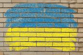 Flag Of Ukraine On Grunge Brick Wall Painted With Chalk