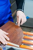 A Professional Carpenter Processes The Plastic Edges Of The Countertop With A Knife-edge Cut. The Co poster