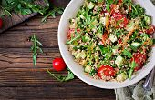 Salads With Quinoa,  Arugula, Radish, Tomatoes And Cucumber In Bowl On  Wooden Background.  Healthy  poster