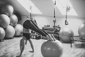 Woman Athlete Do Handstand With Legs On Fit Ball. Girl In Sportswear Training On Fitball In Gym. Bal poster