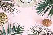 Summer Composition. Tropical Palm Leaves, Hat, Pineapple, Coconut On Pastel Pink Background. Summer  poster