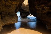 Cave At The Rocky Coastline Of Lagos, Algarve, Portugal poster