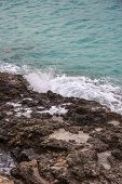 Wave Meets The Rocky Coast At Blue Lagoon Bay, Limestone Eroded Rocks And Crystal Cyan Water, Comino poster