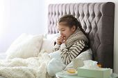 Sick Little Girl With Cough Suffering From Cold In Bed poster