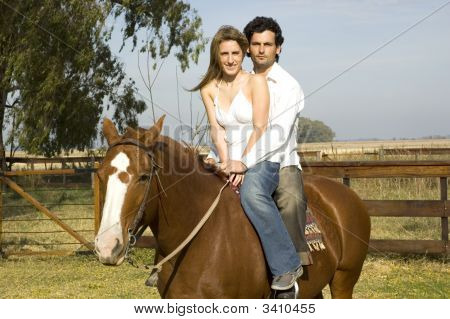 Young Couple Riding Their Horse