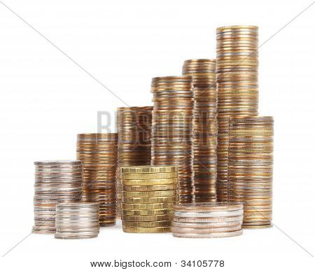 Stacks Of Silver And Golden Coins Isolated
