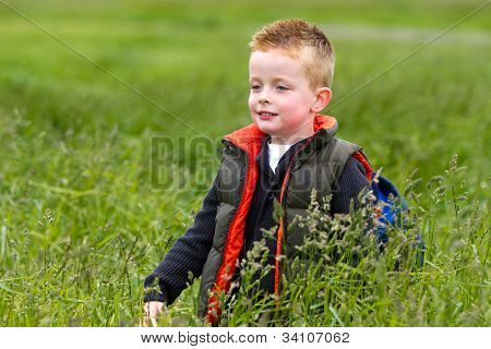 Young Boy Playing In The Fields