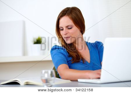 Pretty Blonde Student Woman Smiling And Writing