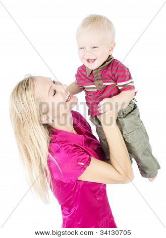 Happy Mother Playing With One Year Child Raising Up