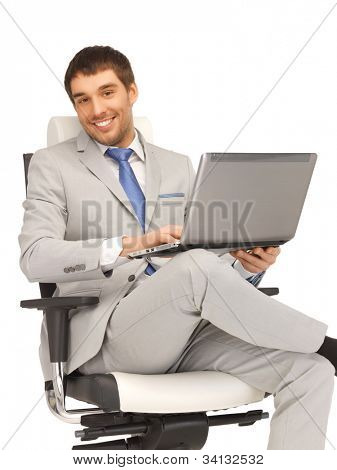 picture of young businessman sitting in chair with laptop