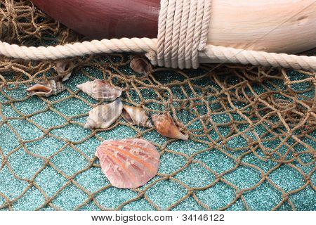 Life preserver with fishing nets and sea shells.  Beach or ocean concept.