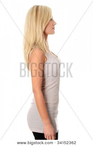 Young beautiful woman is standing sideways and looking at side. Isolated on the white background.