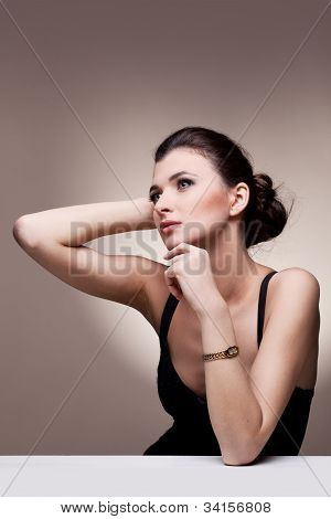 Portrait of luxury woman in exclusive jewelry watch