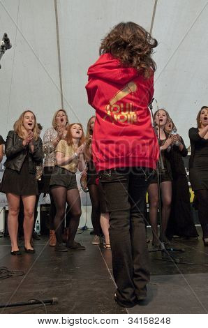 Singer & conductor from University of Exeter Soul Choir perform live on the Global Community Stage