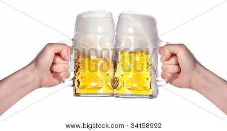 Two Hands Holding Beers Making A Toast