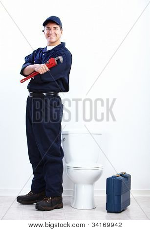 Professional plumber doing toilet reparation. Plumbing repair service.