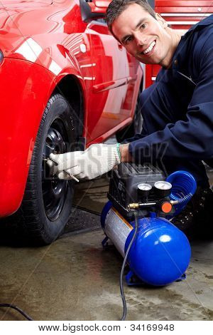 Professional mechanic working in auto repair service..