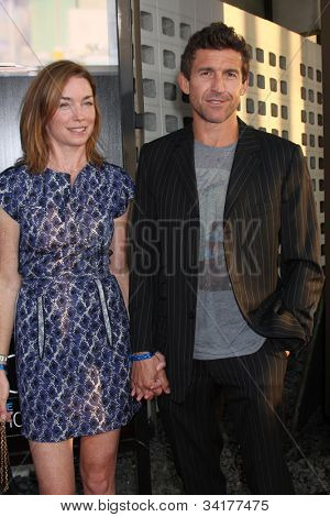 LOS ANGELES - JUN 20:  Julianne Nicholson, Jonathan Cake arrives at HBO's