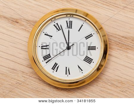 Brass Small Watch Or Clock On Wood Table