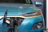 Charging An Electric Or Hybrid Phev Car With The Power Cable Supply Plugged In. Electric Car Chargin poster