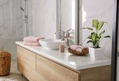Modern Mirror And Vessel Sink In Stylish Bathroom poster