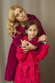 Mom And Daughter In Warm Bathrobes. Warm Relations Between Mother And Daughter. Spend Time Together. poster