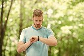 Wearable Technology. Handsome Athlete Using Smartwatch Technology During Training Outdoor. Fit Athle poster