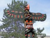 stock photo of totem pole  - Totem pole topped by thunderbird Thunderbird Park Victoria BC Canada - JPG