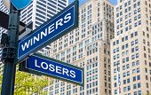 Winners Losers Crossroads Street Sign. Highrise Buildings Background, poster