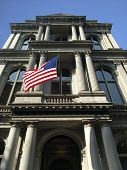 Historic Column Building With Us Flag poster