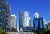 Downtown Miami Cityscape View With Condos And Office Buildings Against Blue Sky. poster