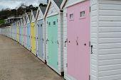 Line Of Beach Huts At Lyme Regis In Dorset. poster